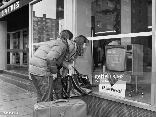 Two young travellers use the Post Office's new Prestel system to check Pan Am flights to the USA from a UK airport 22nd November 1979 Telephone lines...