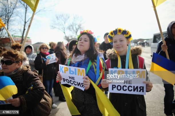 Two young Ukrainian women hold signs that read 'Ukraine not Russia' during a protest against the forthcoming referendum in Crimea on March 14, 2014...