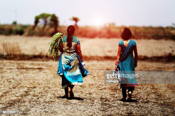 Two young woman going to home from the farm