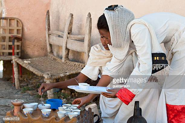 Two young woman in a traditional coffee ceremony, Ethiopia