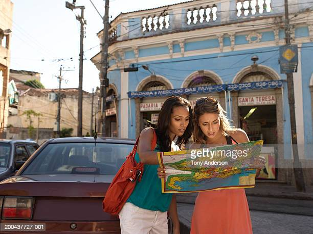 Two young woman looking at map