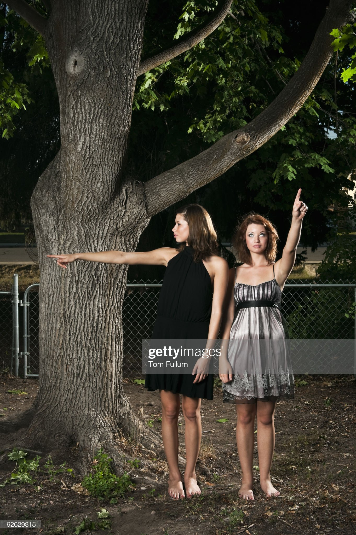 https://media.gettyimages.com/photos/two-young-woman-pointing-picture-id92629815?s=2048x2048