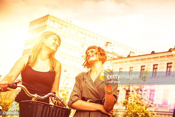 Two young woman relaxing in the city park