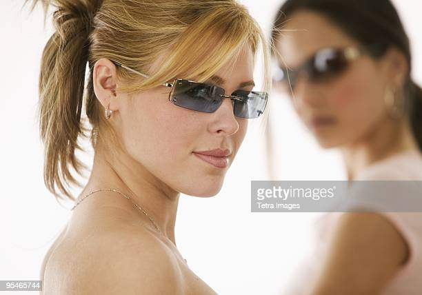 Two young woman wearing sunglasses
