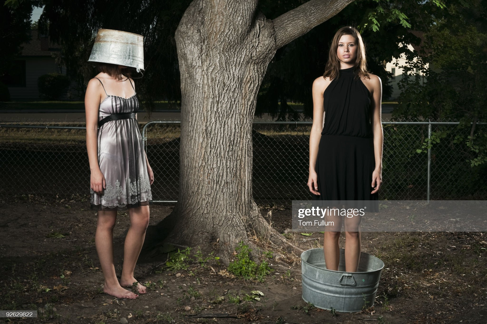 https://media.gettyimages.com/photos/two-young-woman-with-metal-buckets-picture-id92629822?s=2048x2048