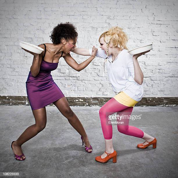 Two Young Women About to Throw Pies at Each Other