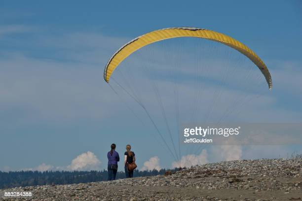 Watching a Paraglider Landing at the Beach