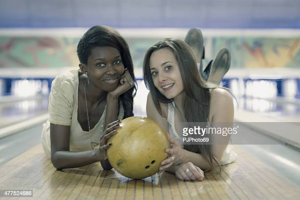 Two young women at bowling