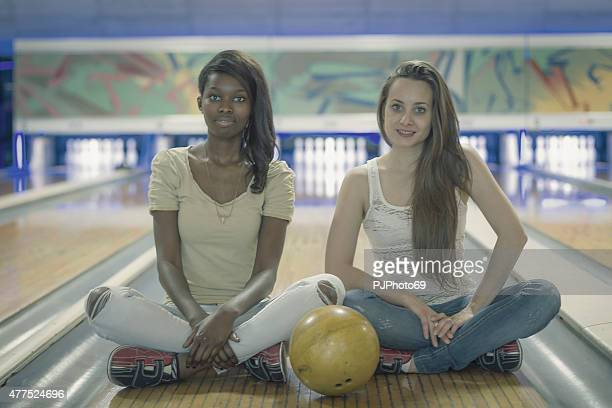 two young women at bowling - pjphoto69 stock pictures, royalty-free photos & images