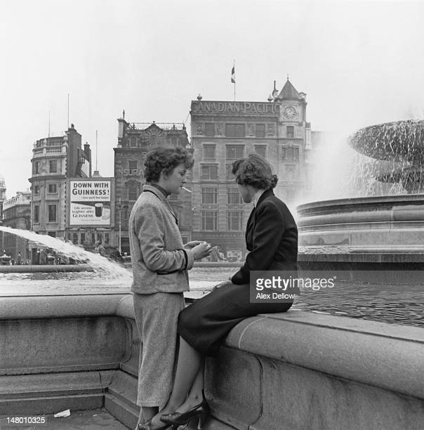Two young women by the fountains in Trafalgar Square London December 1953 Original publication Picture Post 6851 The Best And Worst Of Britain 5 The...
