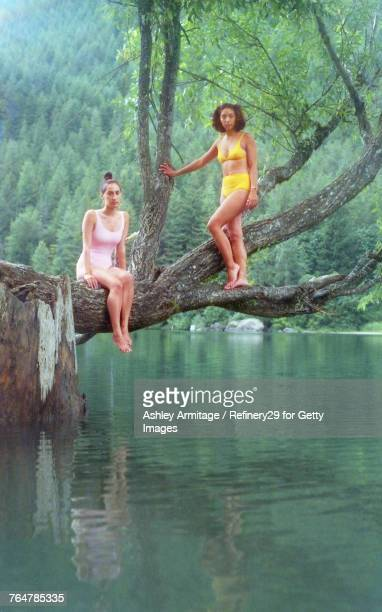 Two Young Women By The Lake