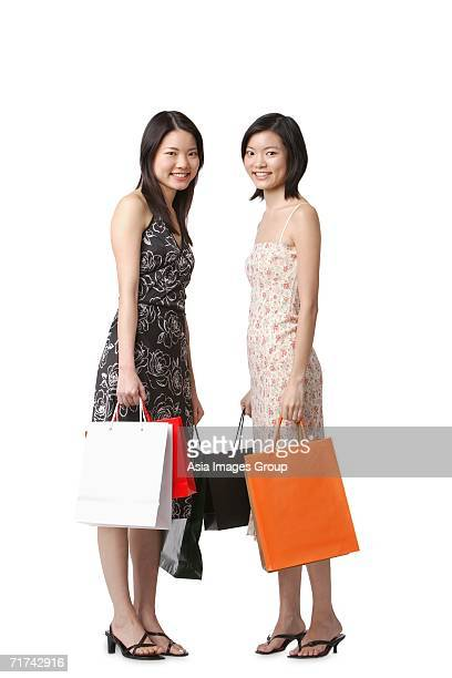 Two young women carrying shopping bags
