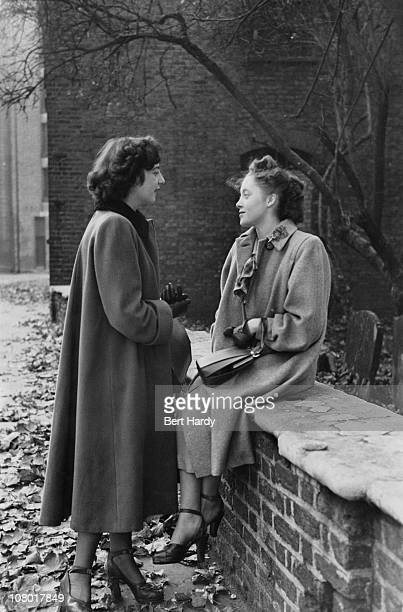 Two young women chatting in the Pool Of London area December 1949 They are Denise Bryan a shop assistant and Mary White a typist Original Publication...