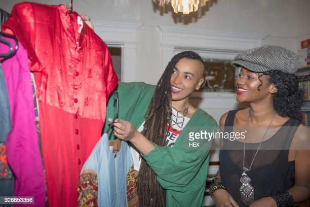 Two young women choosing an outfit
