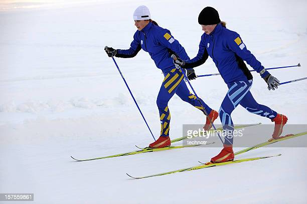two young women cross country skiing - nordic skiing event stock pictures, royalty-free photos & images