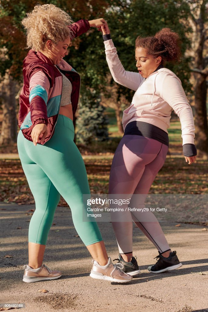 Two Young Women Dancing : Stock Photo