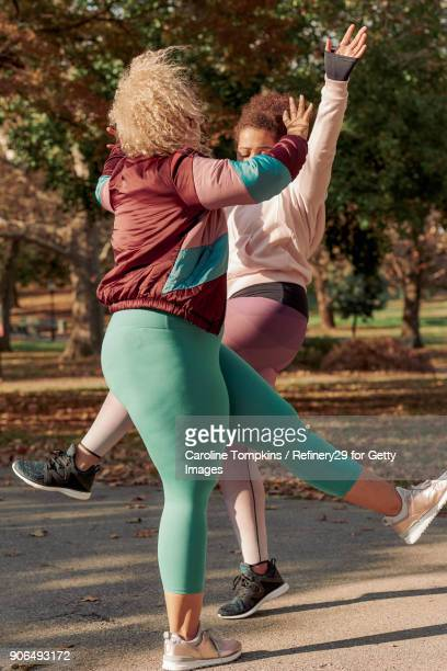 Two Young Women Dancing