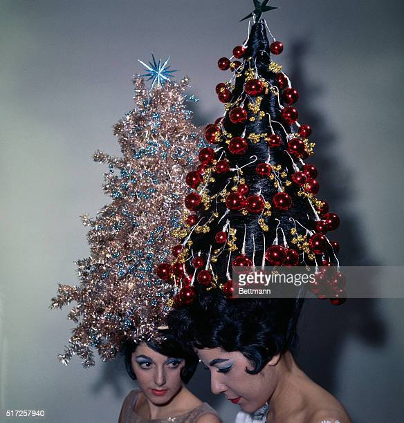 Two young women display their holiday hairdos, each with 42-inch hair decorated with tinsel and ornaments. Claudette Ackrich's hair is decorated with...