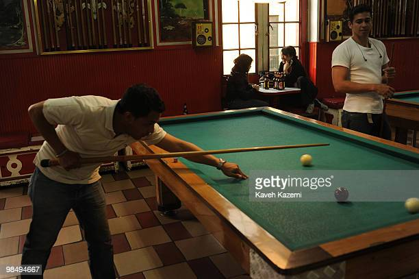 Two young women drink beer in a billiard club in Candeleria Bogota Bogota formerly called Santa Fe de Bogota is the capital city of Colombia as well...