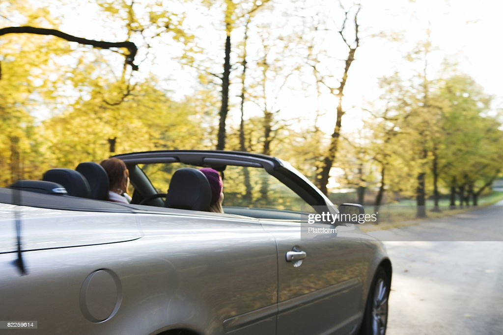 Two young women driving a cabriolet an autumn day Sweden. : Stock Photo