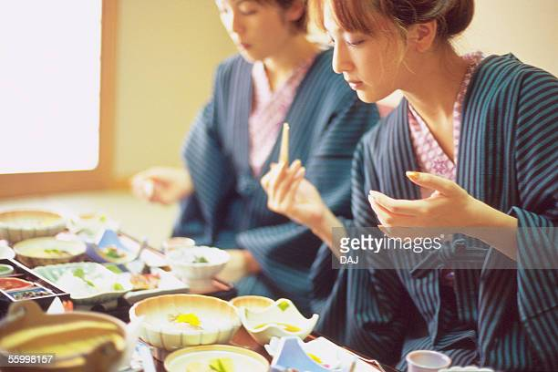 Two Young Women Eating a Meal