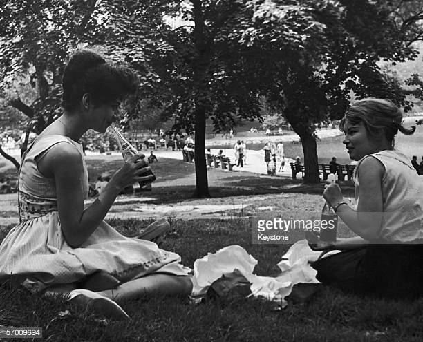 Two young women eating lunch in Central Park New York July 1961
