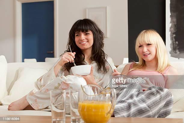 Two young women enjoying breakfast