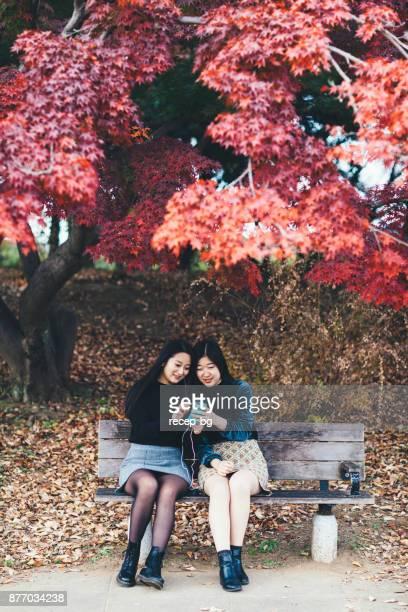 Two Young Women Enjoying Listening To Music