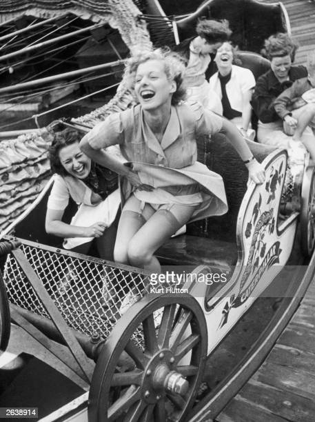 Two young women enjoying themselves on the 'Caterpillar' ride at Southend Fair Essex October 1938 Original Publication Picture Post 409 October Month...