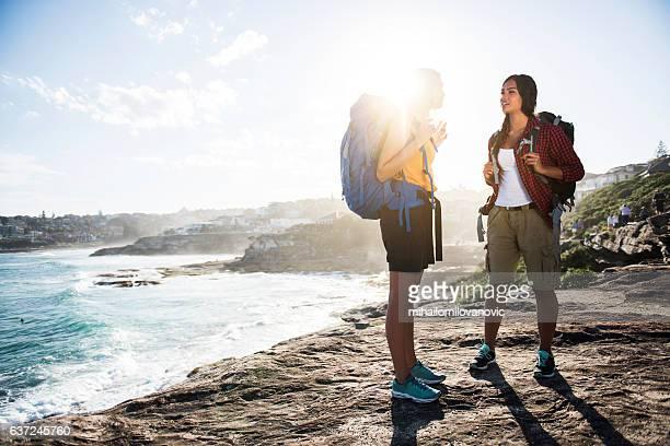 Two young women exploring coastline