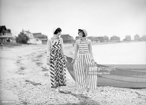 Two young women flappers show off their modern clothing along the Massachusetts shore in the 1920s