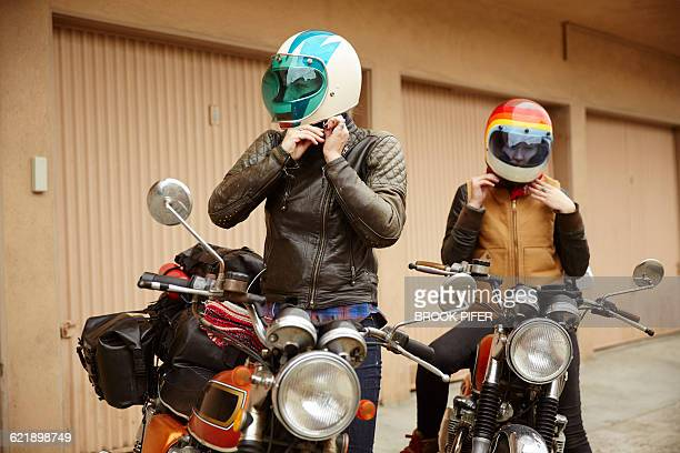 two young women getting ready for motorcycle trip - biker jacket stock pictures, royalty-free photos & images