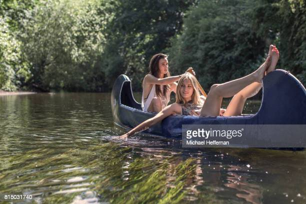 Two young women having fun in a canoe