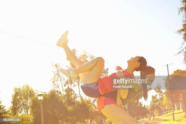 Two young women having fun in park