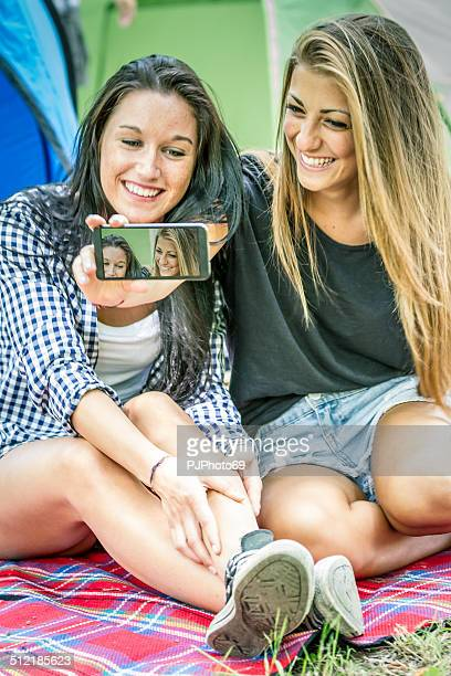 two young women having fun with smartphone - pjphoto69 stock pictures, royalty-free photos & images