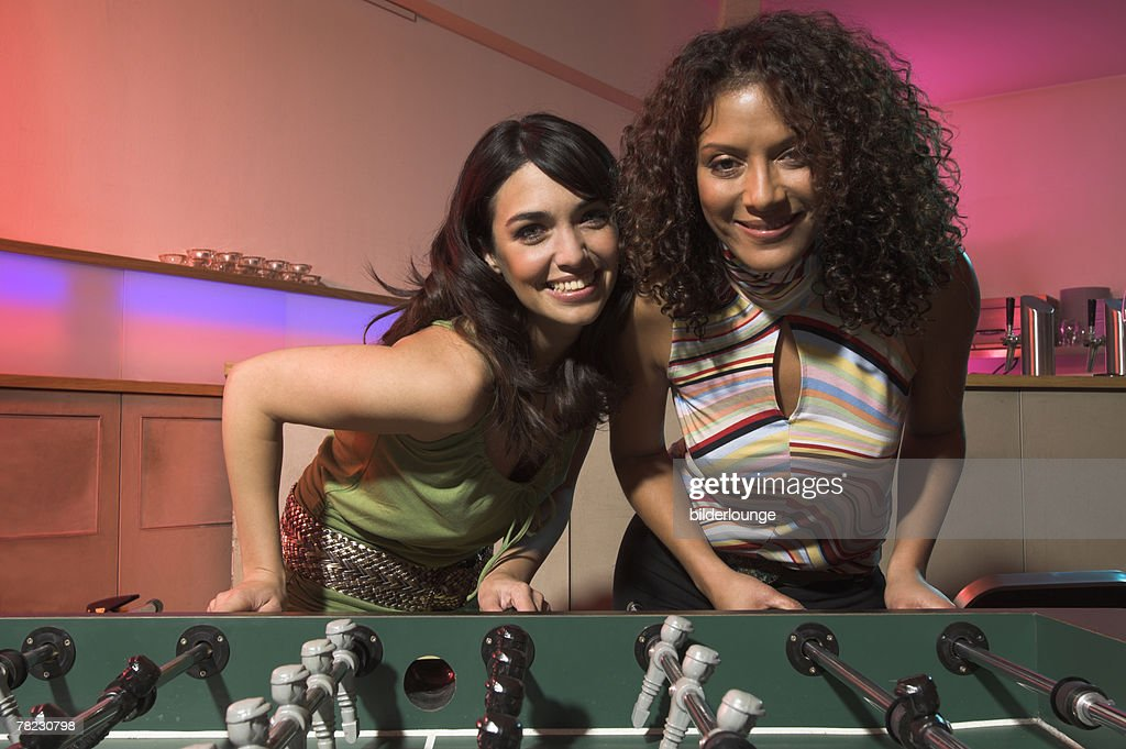 Two Young Women Having Fun With Tabletop Football In Bar Stock Photo ... 30b5d7cafd