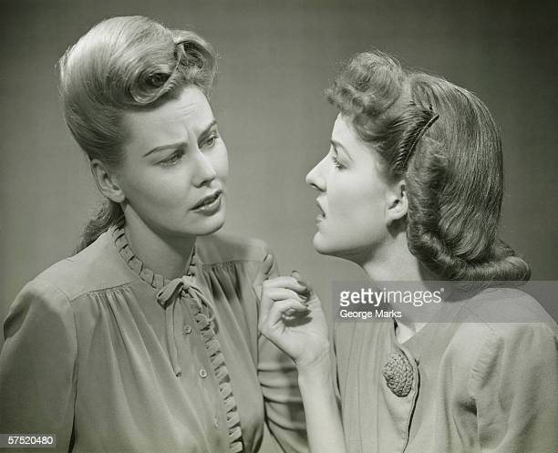 two young women having serious discussion, (b&w) - beehive hair stock pictures, royalty-free photos & images