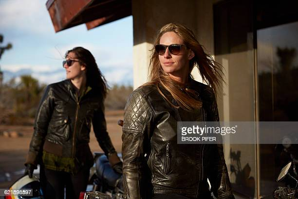 two young women heading out for motorcycle ride - biker jacket stock pictures, royalty-free photos & images