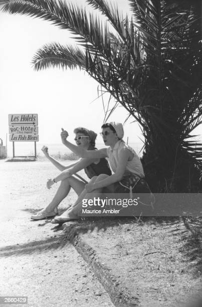 Two young women hitchhiking on the French Riviera Original Publication Picture Post 7226 We Hitch Hiked To The Sun For 5 pub 1954