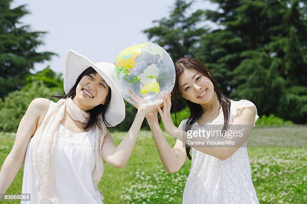 Two young women holding ball