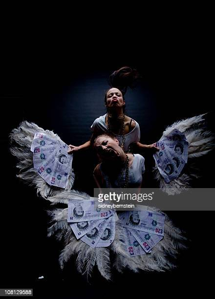 Two Young Women Holding Feathers and Money