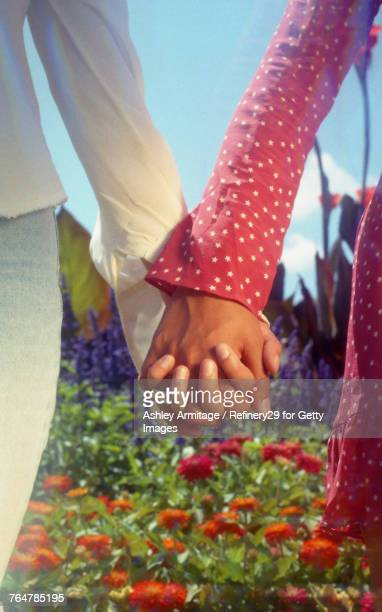Two Young Women Holding Hands