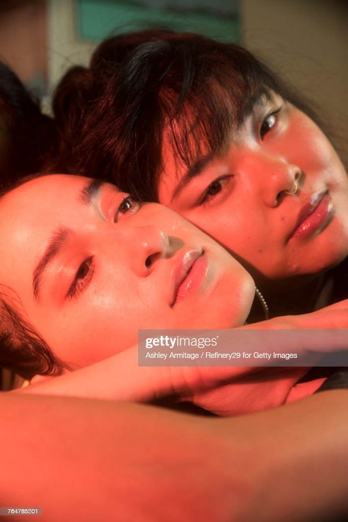 Two Young Women In Bedroom  : Stock Photo