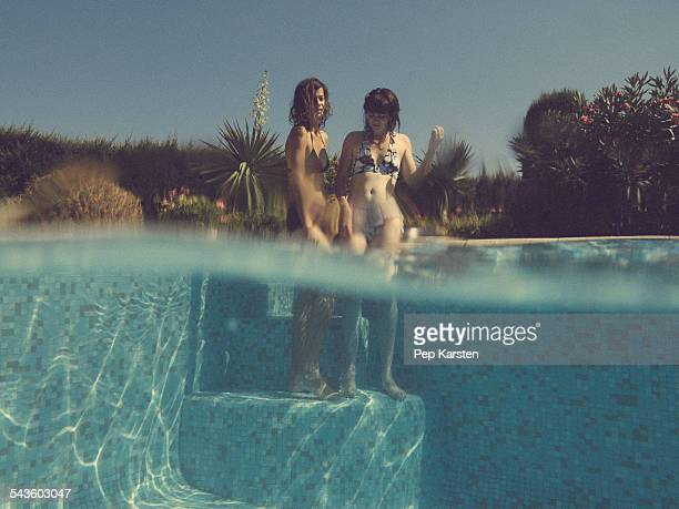 Two young women in swimming pool