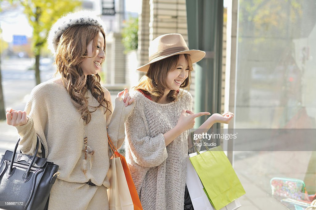 Two young women in the city : Stock Photo