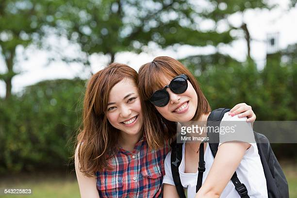 Two young women in the park.