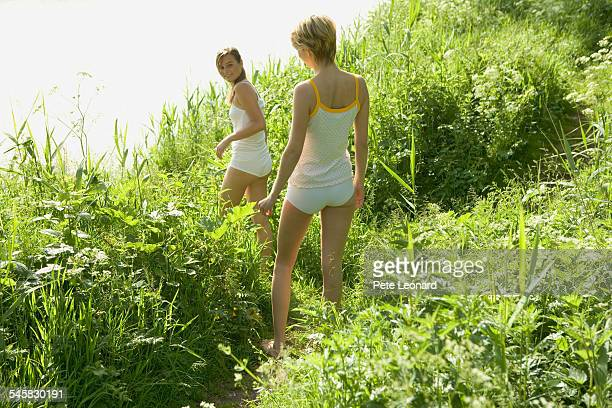Two Young Women in Underwear at a Lake