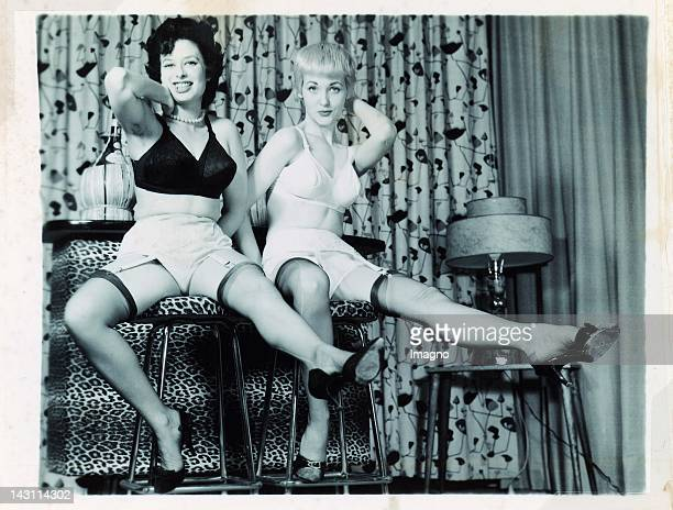 Two young Women in Underwear sitting on bar stools Photograph