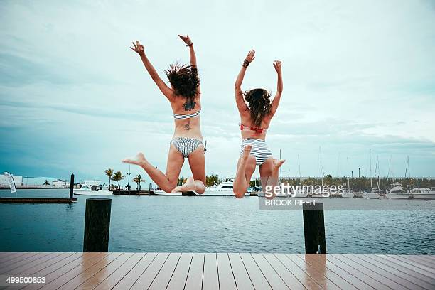 Two young women jumping in air