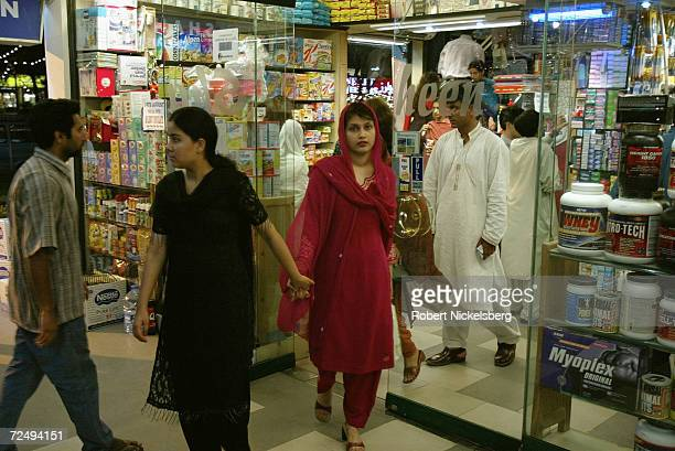 Two young women leave a popular shop in an Islamabad Pakistan shopping mall complex on August 14 2004